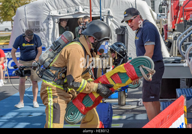 Firefighters in full turn out gear waiting to compete. - Stock Image