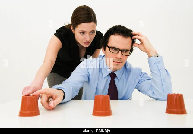 Couple ponder location of hidden item - Stock Image