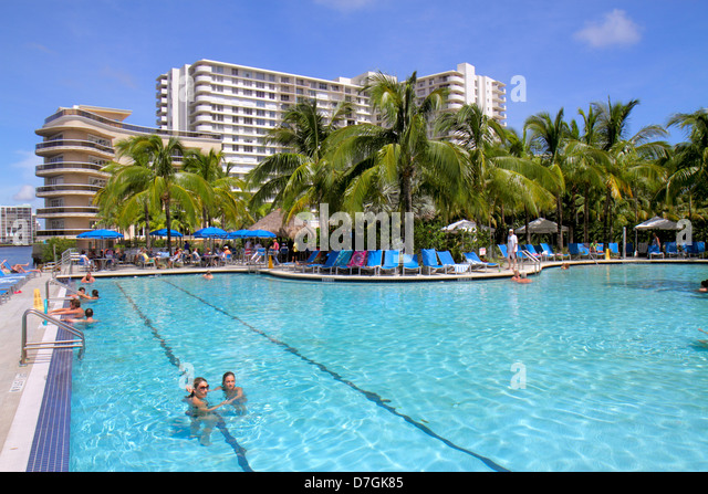 Hollywood Florida Crowne Plaza Hollywood Beach hotel swimming pool area girl teen palm trees - Stock Image