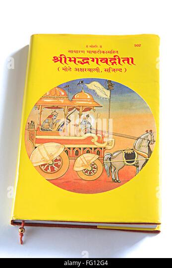 Concept , Shree Mudh Bhagvad gita theological book episode of Mahabharata on white background - Stock Image