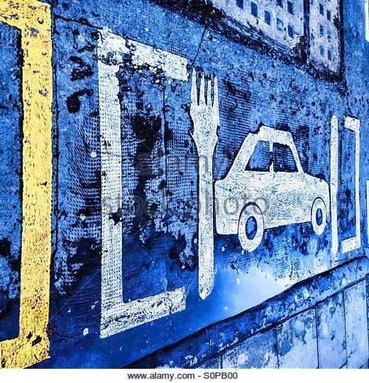 Pavement Art designating a Parking Space for a Restaurant, Brick Lane, London - Stock Image