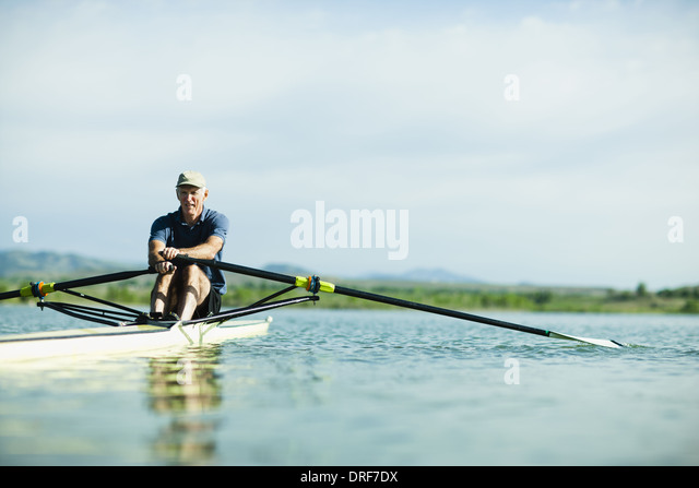 Colorado USA middle-aged man rowing single scull rowing boat - Stock Image