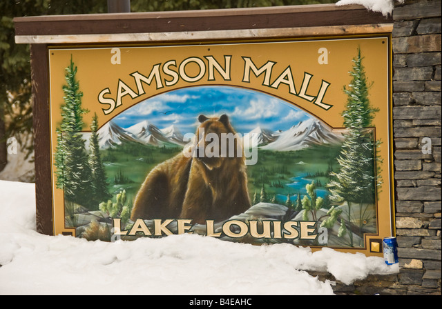 Lake Louise Canada Samson Mall sign half-buried by snow with grizzly bear, canadian shopping mall - Stock Image