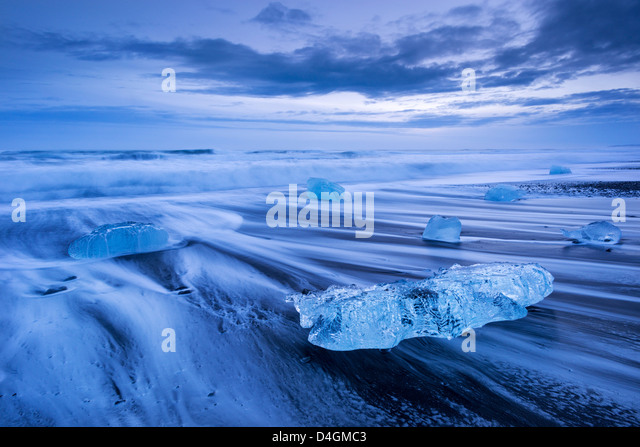 Ice and waves on Jokulsarlon Beach, South Iceland. Winter (January) 2013. - Stock Image