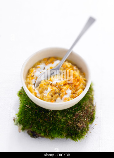 Orange lentils with yoghurt and cumin - Stock Image