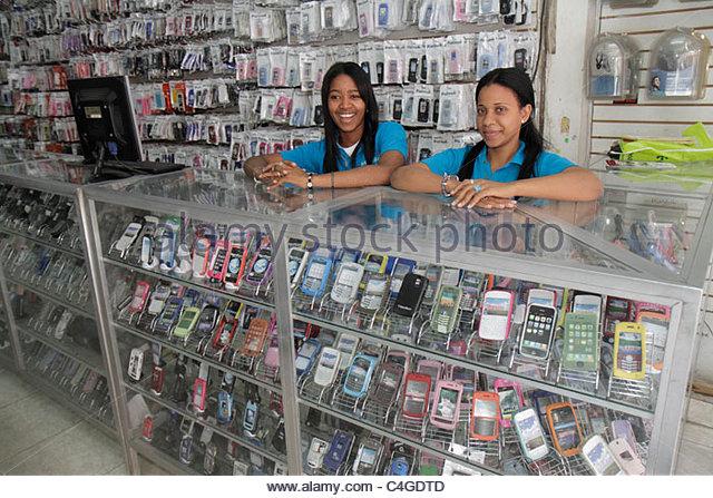 Santo Domingo Dominican Republic Avenida Mexico store business electronics retail display case PDA smart phone accessory - Stock Image