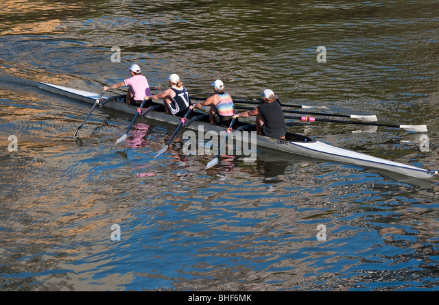 A womans' fours rowing team training on the Yarra River in Melbourne - Stock Image