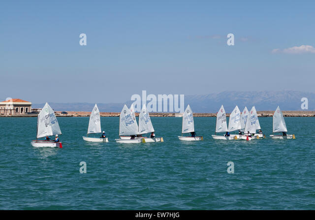 Sailing lessons for children in the bay of the city of Chios, on the isle of Chios, Greece - Stock Image