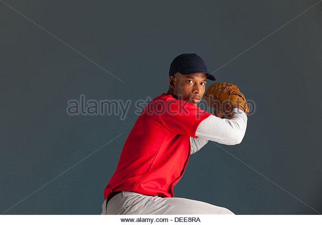 Baseball player winding up a pitch - Stock Image