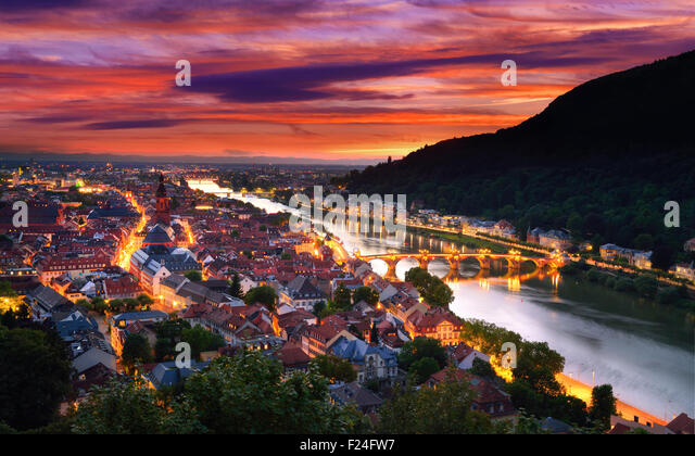 Heidelberg, Germany, aerial view at dusk, with dramatic sunset sky and the lights of the city, Neckar river and - Stock Image