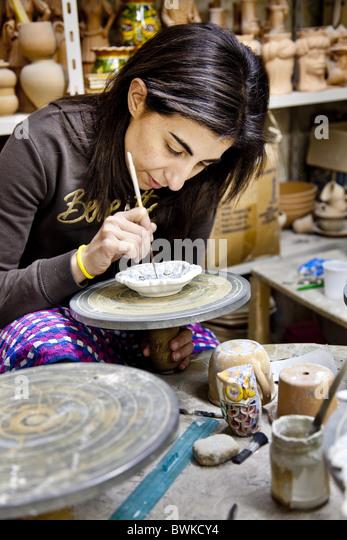 Women painting pottery, Caltegirone, Sicily, Italy - Stock-Bilder