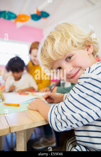 Student drawing in classroom - Stock Image