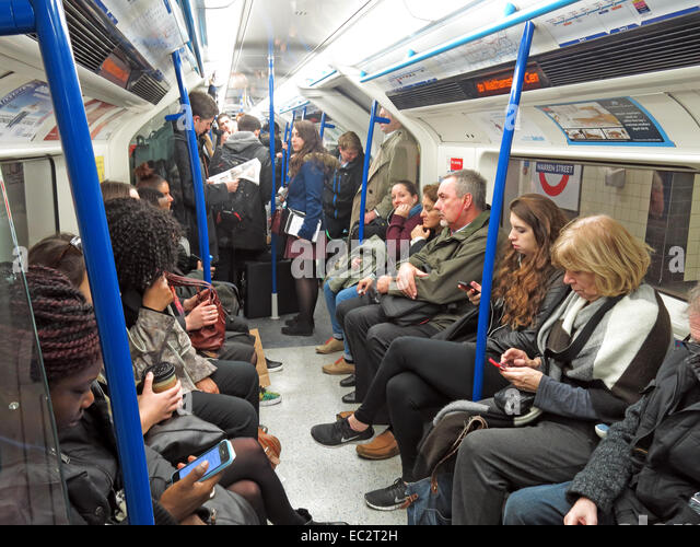 Busy Victoria Tube line train in London Underground - Stock Image