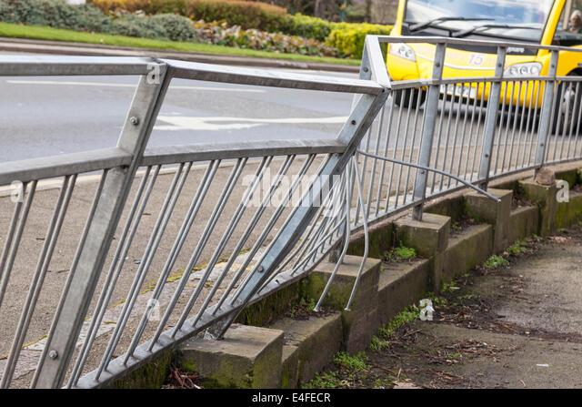 Damaged crash barrier on a road - Stock Image
