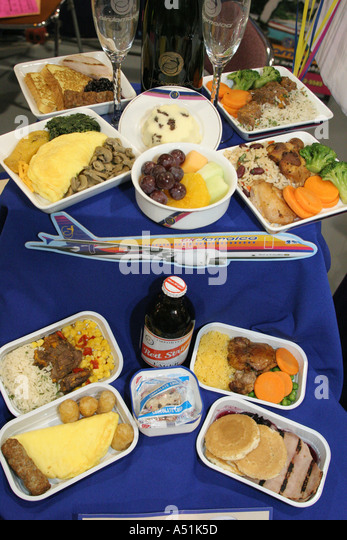 Coconut Grove Florida Convention Center Miami Herald Travel Expo Air Jamaica meal service display - Stock Image