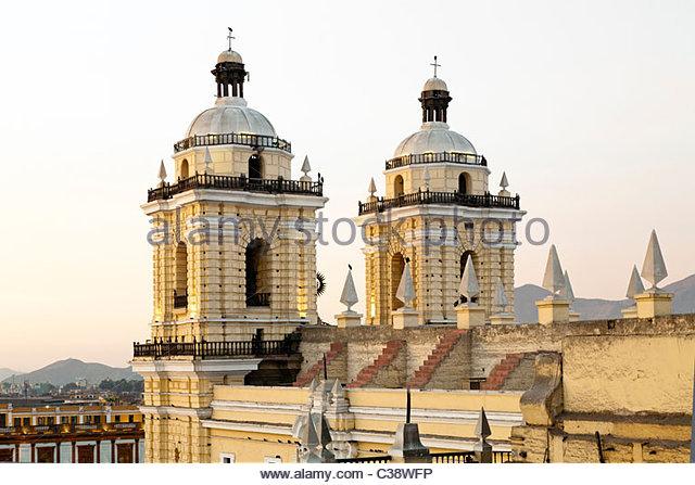 Rear view of Basilica y Convento de San Francisco de Lima (Saint Francis Monastery) at sunset. Lima, Peru - Stock Image