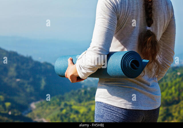 Woman standing with yoga - Stock Image