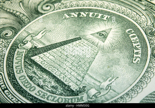 Macro closeup eye pyramid on back of dollar bill - Stock Image