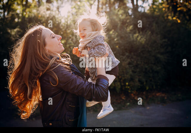 young family walking in the park - Stock-Bilder