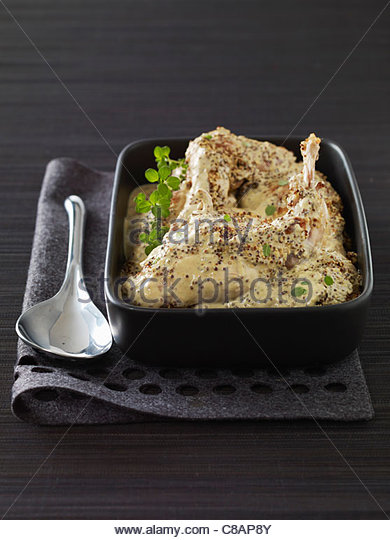 Rabbit with cream and mustard sauce - Stock Image