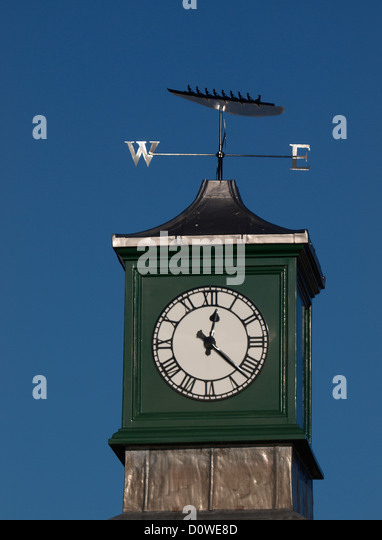 Clock tower and weather vein on top a boathouse, Cambridge, UK - Stock Image