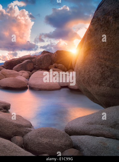 Storm clouds and granite boulders on east side of Lake Tahoe, Nevada - Stock Image