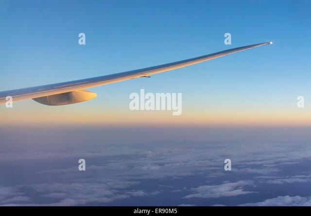 Aircraft wing from passenger cabin at sunset - Stock-Bilder