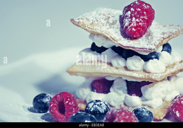 Cake with fruits and whipped cream - Stock Image