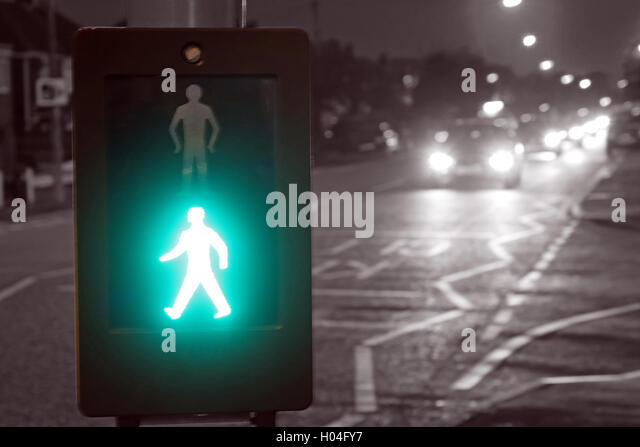 Pelican Crossing with green man, safe to cross, England, UK - Stock Image