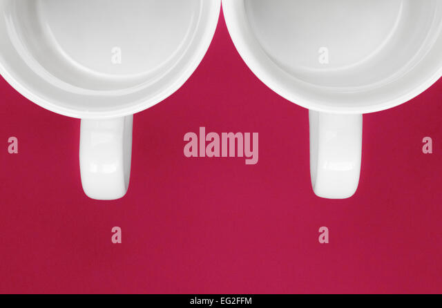 Two white Mugs overhead - Stock Image