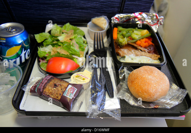 Chicago Illinois O'Hare International Airport ORD onboard United commercial airliner cabin meal lunch food salad - Stock Image