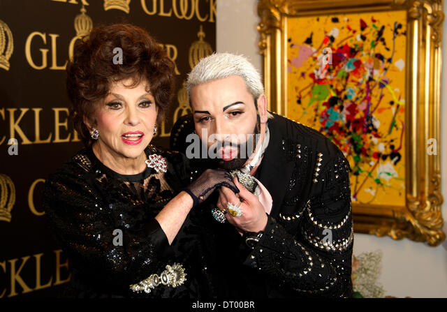 Berlin, Germany. 04th Feb, 2014. Italian artist Gina Lollobrigida and fashion designer Harald Glööckler - Stock-Bilder