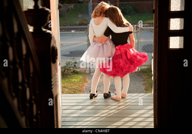 Girls standing together on porch - Stock Image