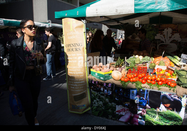 Real Food Market selling fresh organic vegetables from a stall. South Bank, London, UK. - Stock Image
