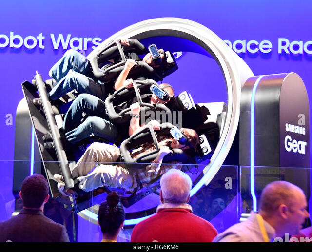 Las Vegas Nevada, USA. 5th Jan, 2017. CES attendees take a wild ride on the Samsung race chair during Day 1 of the - Stock Image
