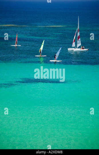 Wind surfing at Platja des Pujols, Formentera. - Stock Image