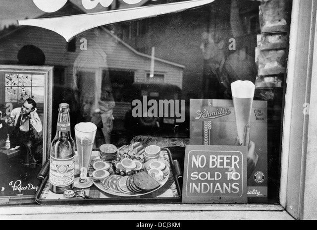 No Beer Sold to Indians - Sign in beer parlor window, Sisseton, South Dakota, circa 1939 - Stock Image