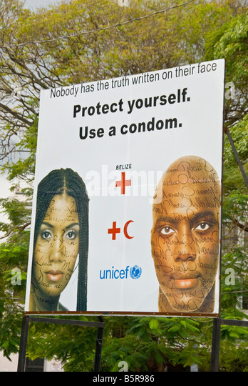 Belize City Aids Awareness UNICEF billboard urges condom use sexually transmitted disease prevention program - Stock Image