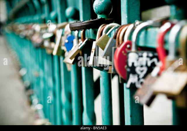 Padlock hanging on one of the bridges in Wroclaw - Stock Image