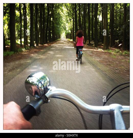 Going for a bike ride in a forest - Stock Image