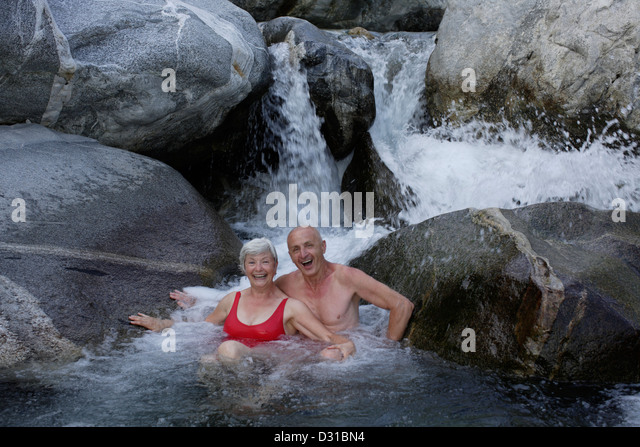 seniors while bathing in the mountain river - Stock-Bilder
