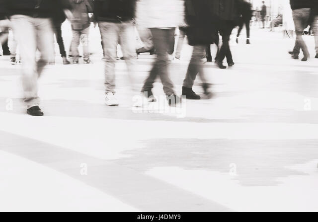 abstract blur background of people crossing the street on zebra - Stock Image