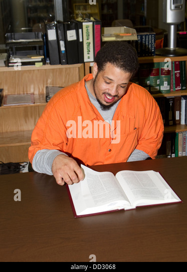 Inmate trying to better himself by going to school while incarcerated. Here doing homework. - Stock Image