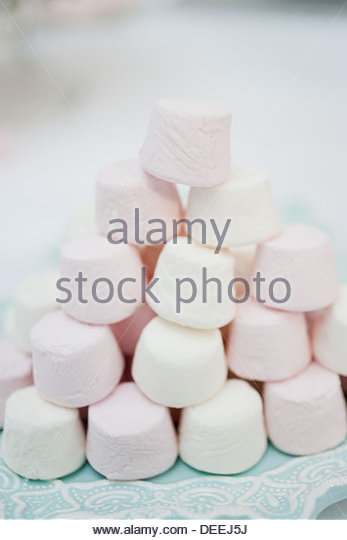 Stack of pastel colored marshmallows - Stock Image