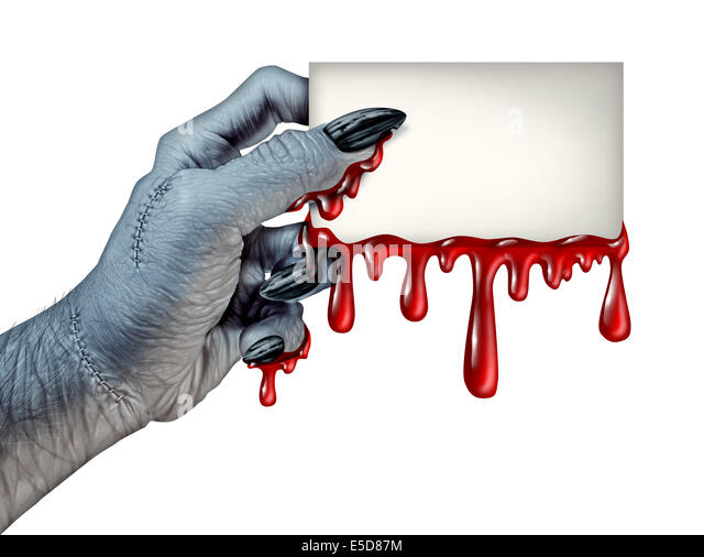 Zombie monster hand holding a blank blood dripping card sign on a side view as a creepy halloween or scary symbol - Stock Image