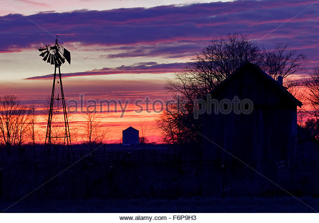 Old windmill and barn at sunset, southern Indiana - Stock Image