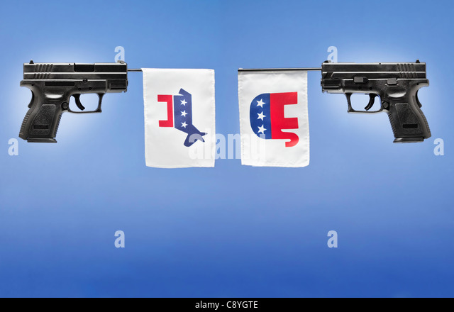 Studio shot of guns with political parties symbols - Stock Image