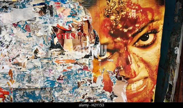 angry woman on Tattered hindi film poster in mumbai india - Stock-Bilder