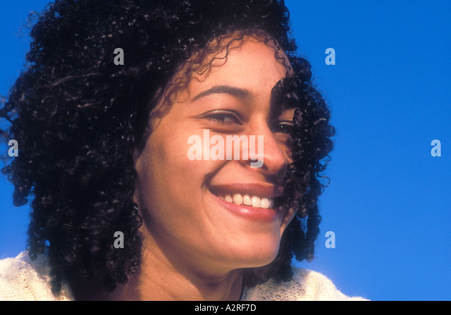 Portrait of smiling mixed Caucasian African American female - Stock Image