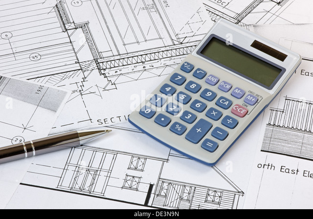 A calculator and pen on some house plans. Plans are copyright-free - Stock Image